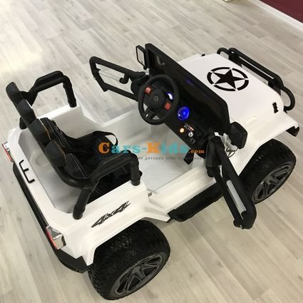 Электромобиль Jeep Wrangler 2WD WXE1688 белый (2х местный, задний привод, колеса резина, сиденье кожа, пульт, музыка)